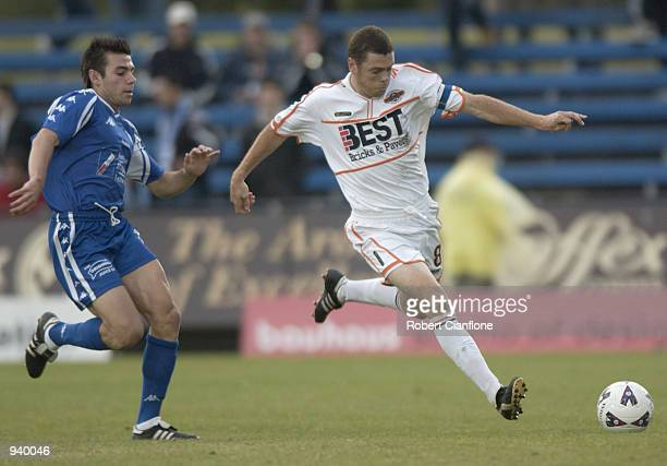 Carl Veart for Adelaide City is put under pressure by Nick Tolios for South Melbourne during the round 9 NSL match played between South Melbourne and...