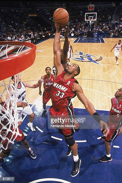 Center Alonzo Mourning of the Miami Heat rebounds the ball during the NBA game against the Washington Wizards at the MCI Center in Washington...
