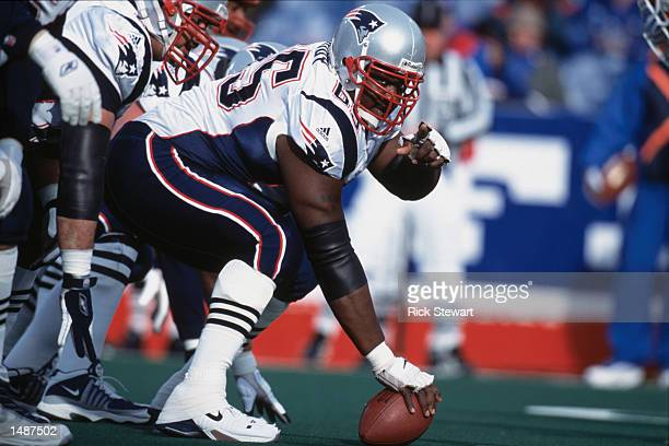 Center Damien Woody of the New England Patriots gets ready to hike the ball during the game against the Buffalo Bills at the Ralph Wilson Stadium in...