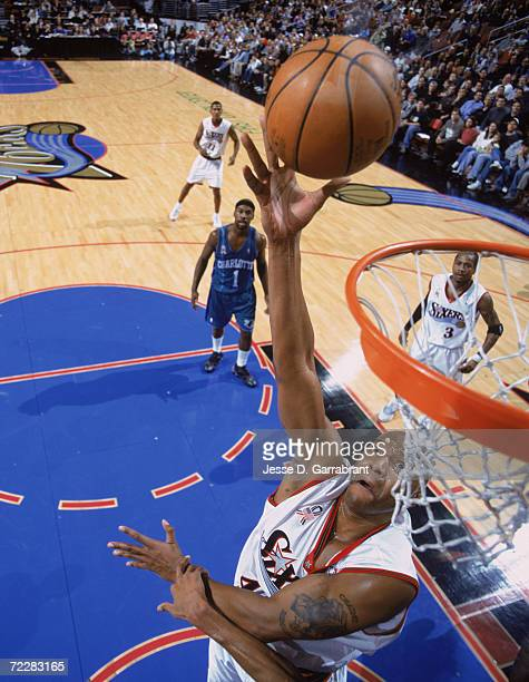 Center Derrick Coleman of the Philadelphia 76ers shoots the ball during the NBA game against the Charlotte Hornets at the First Union Center in...