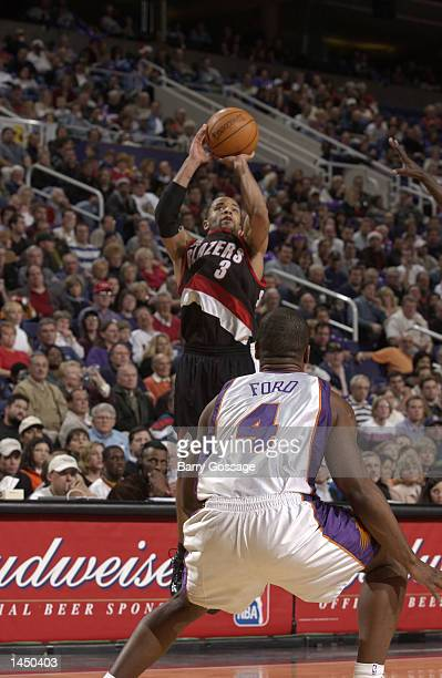 Damon Stoudamire of the Portland Trailblazers shoots over Alton Ford of the Phoenix Suns during a NBA game at America West Arena in Phoenix Arizona...
