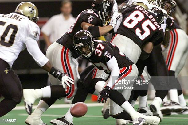 Darrick Vaugn of the Atlanta Falcons fumbles the ball during the game against the New Orleans Saints at the Georgia Dome in Atlanta Georgia The...