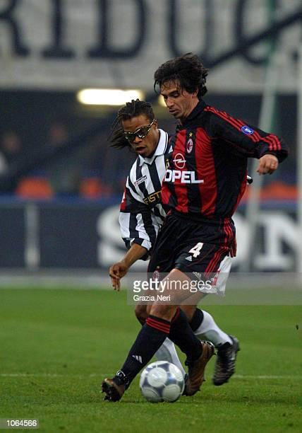 Demetrio Albertini of AC Milan and Edgar Davids of Juventus in action during the Serie A 14th Round League match between AC Milan and Juventus played...