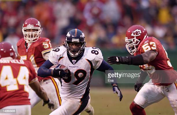 Dwayne Carswell of the Denver Broncos outruns Marvcus Patton of the Kansas City Chiefs during the game at Arrowhead Stadium in Kansas City Missouri...