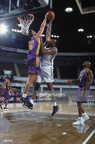 Dwayne Schintzius of the Mobile Revelers blocks Lorenzo Coleman of the Roanoke Dazzle during the NBDL game at the Mobile Civic Center in Mobile...