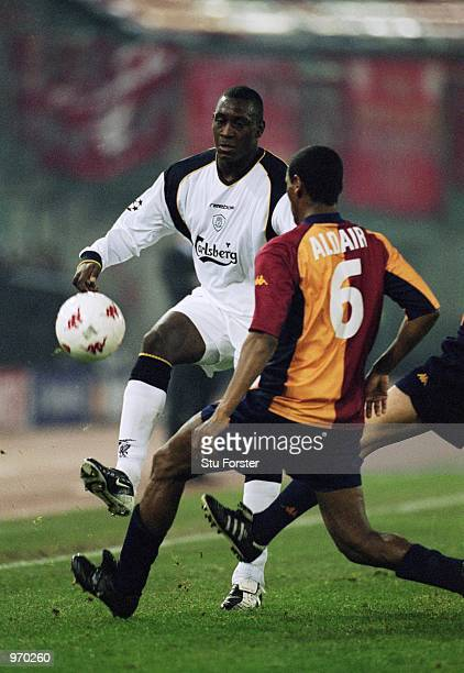 Emile Heskey of Liverpool knocks the ball past Aldair of AS Roma during the UEFA Champions League Group B match played at the Stadio Olimpico in Rome...