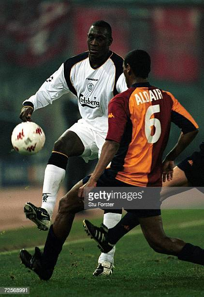Emile Heskey of Liverpool takes on Aldair of Roma during the UEFA Champions League Stage Two Group B match between AS Roma and Liverpool at the...