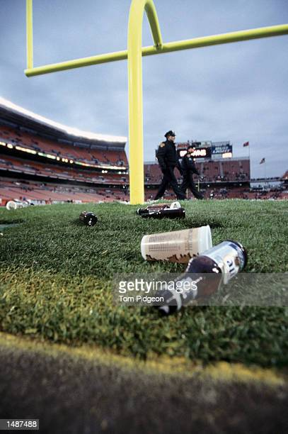 Fans throw beer bottles and trash onto the field after a bad call by the referees allowing the Jaguars to win during the NFL game between the...