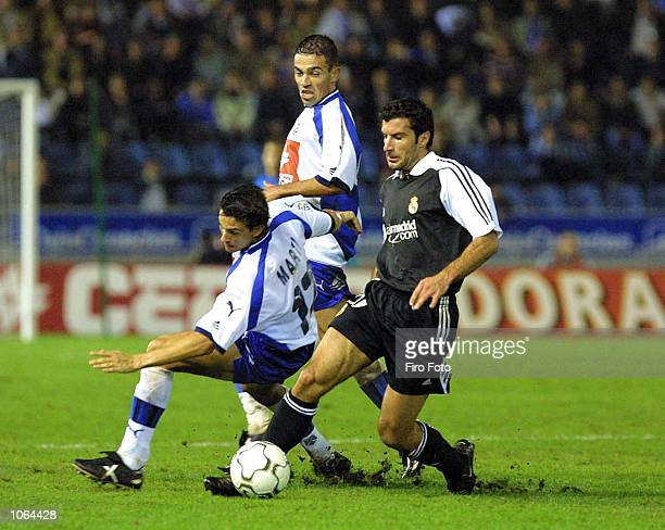Figo of Real Madrid and Marti of Tenerife in action during the Spanish Primera Liga match played between Tenerife and Real Madrid at the Heliodoro...