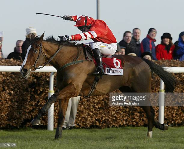 Florida Pearl ridden by Adrian Maguire storms up the final straight during his victory in the King George VI Chase at Kempton Park racecourse near...
