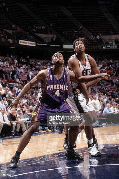 Forward Alton Ford of the Phoenix Suns boxes out forward Jason Collins of the New Jersey Nets during the NBA game at Continental Airlines Arena in...
