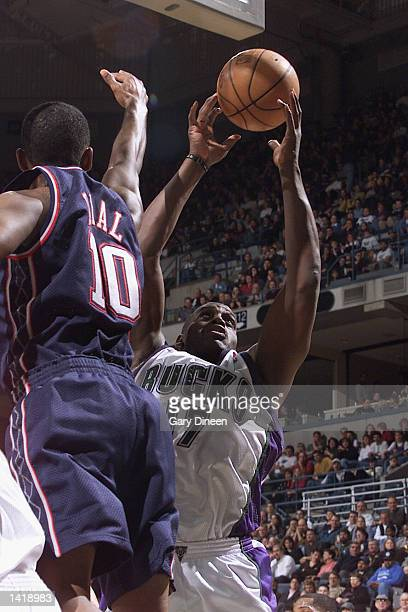 Forward Anthony Mason of the Milwaukee Bucks goes up for the shot during the NBA game against the New Jersey Nets at the Bradley Center in Milwaukee...