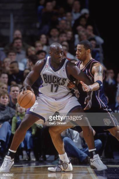 Forward Anthony Mason of the Milwaukee Bucks posts up forward Kenyon Martin of the New Jersey Nets during the NBA game at the Bradley Center in...
