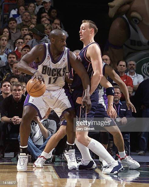 Forward Anthony Mason of the Milwaukee Bucks working his way towards the basket against Keith Van Horn during the NBA game against the New Jersey...