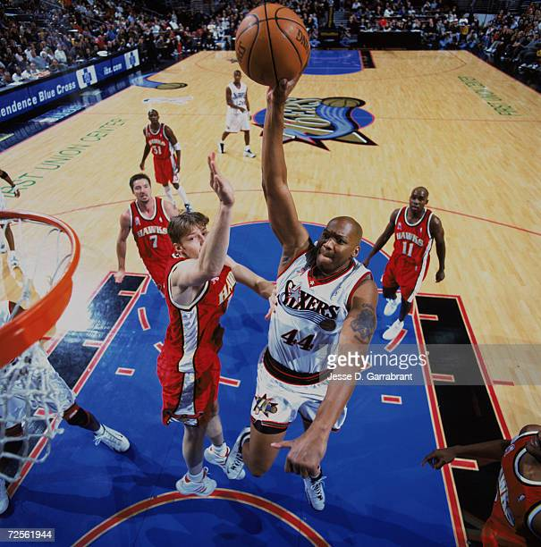 Forward Derrick Coleman of the Philadelphia 76ers shoots over forward Hanno Mottola of the Atlanta Hawks during the NBA game at the First Union...