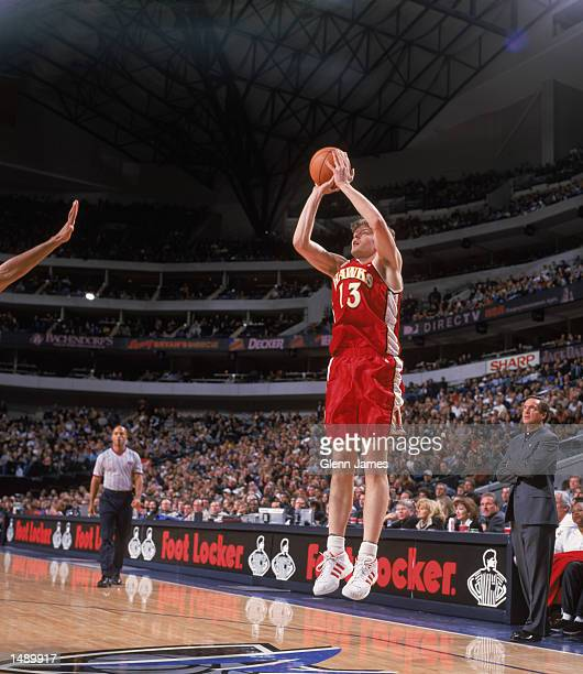 Forward Hanno Mottola of the Atlanta Hawks shoots the ball during the NBA game against the Dallas Mavericks at the American Airlines Center in Dallas...