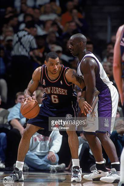 Forward Kenyon Martin of the New Jersey Nets posts up forward Anthony Mason of the Milwaukee Bucks during the NBA game at the Bradley Center in...
