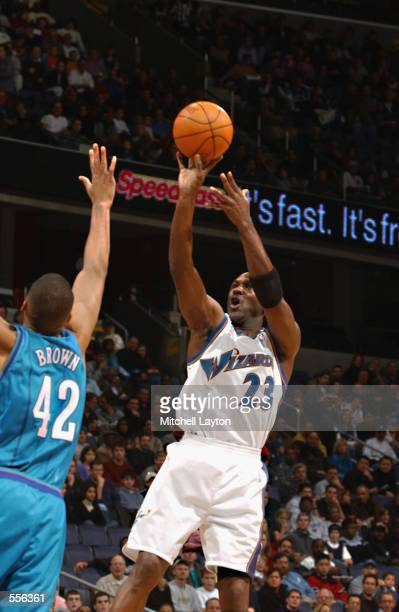 Forward Michael Jordan of the Washington Wizards shoots the ball as forward PJ Brown of the Charlotte Hornets attempts to block during the NBA game...