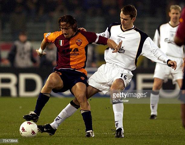 Franesco Totti of Roma holds off the challenge of Dietmar Hamann of Liverpool during the UEFA Champions League Stage Two, Group B match between AS...