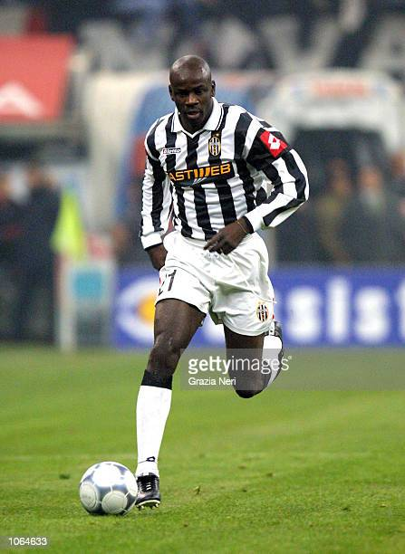 French defender Lilian Thuram in action during the Serie A 14th Round League match between AC Milan and Juventus played at the San Siro Stadium in...