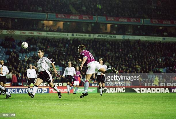 Gareth Barry of Aston Villa heads the ball towards goal during the FA Barclaycard Premiership match against Ipswich Town played at Villa Park in...