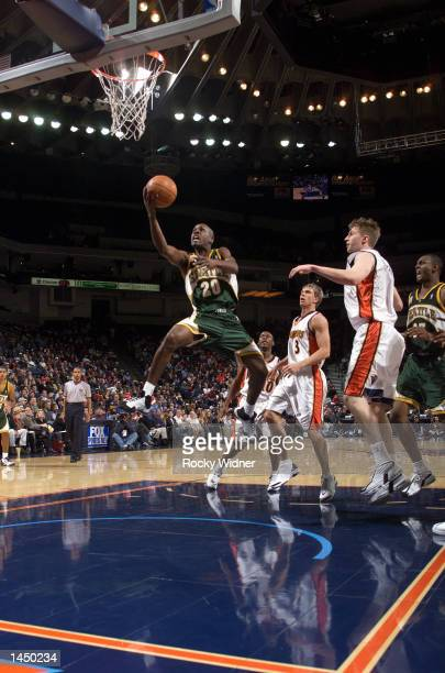 Gary Payton of the Seattle SuperSonics drives to the basket against the Golden State Warriors at The Arena in Oakland California DIGITAL IMAGE NOTE...