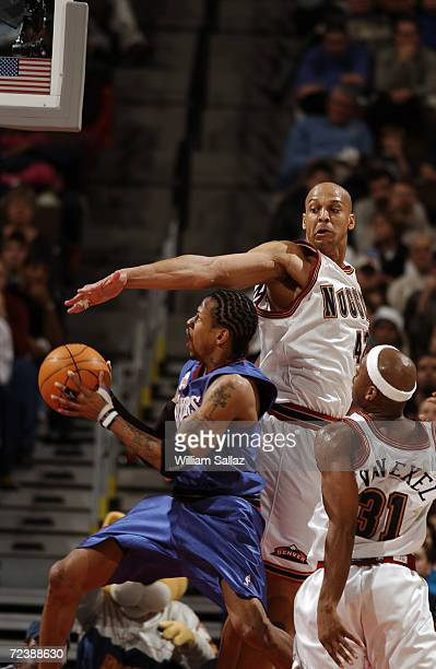 Guard Allen Iverson of the Philadelphia 76ers shoots past forward Scott Williams of the Denver Nuggets during the NBA game at the Pepsi Center in...