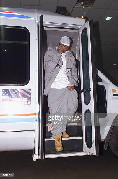 Guard Allen Iverson of the Philadelphia 76ers talks on his cell phone as he leaves the team bus before the NBA game against the Memphis Grizzlies at...
