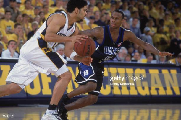 Guard Dommanic Ingerson of the Michigan Wolverines drives past guard Daniel Ewing of the Duke Blue Devils during the NCAA basketball game at Crisler...