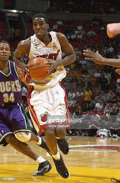Guard Eddie Jones of the Miami Heat drives past guard Ray Allen of the Milwaukee Bucks during the NBA game at American Airlines Arena in Miami...