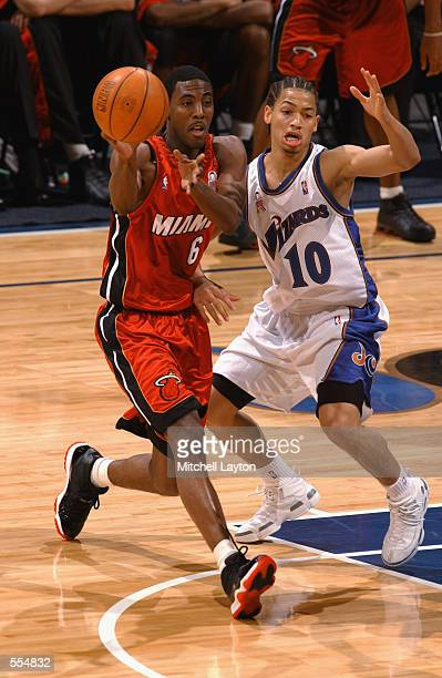 Guard Eddie Jones of the Miami Heat passes away from point guard Tyronn Lue of the Washington Wizards during the NBA game at MCI Center in Washington...