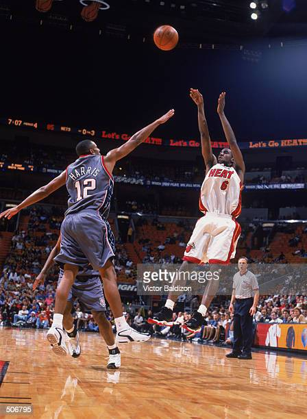 Guard Eddie Jones of the Miami Heat shoots the ball as guard Lucious Harris of the New Jersey Nets attempts to block during the NBA game at American...