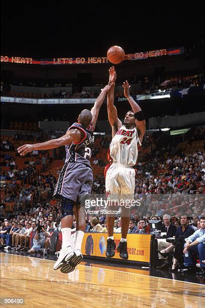 Guard Jim Jackson of the Miami Heat shoots over forward Richard Jefferson of the New Jersey Nets during the NBA game at American Airlines Arena in...