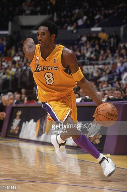 Guard Kobe Bryant of the Los Angeles Lakers dribbles the ball during the NBA game against the Seattle SuperSonics at the Staples Center in Los...
