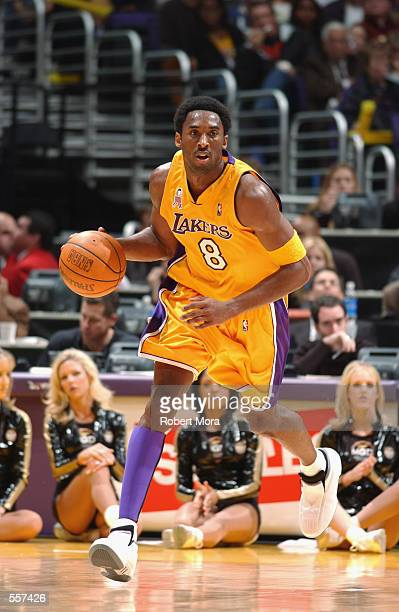 Guard Kobe Bryant of the Los Angeles Lakers dribbles the ball during the NBA game against the Los Angeles Clippers at Staples Center in Los Angeles...