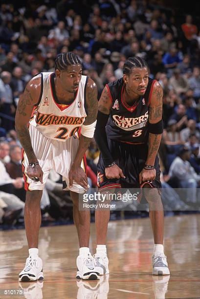 Guard Larry Hughes of the Golden State Warriors and guard Allen Iverson of the Philadelphia 76ers wait for the ball during the NBA game at the Arena...