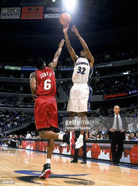 Guard Richard Hamilton of the Washington Wizards shoots over guard Eddie Jones of the Miami Heat during the NBA game at the MCI Center in Washington...