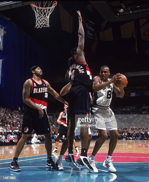 Guard Steve Smith of the San Antonio Spurs looks to shoot over forward Ruben BoumtjeBoumtje of the Portland Trail Blazers during the NBA game at the...