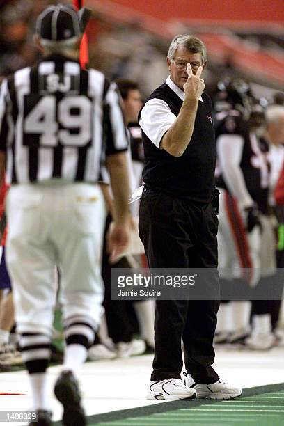 Head coach Dan Reeves of the Atlanta Falcons communicates with an official during the game against the New Orleans Saints at the Georgia Dome in...
