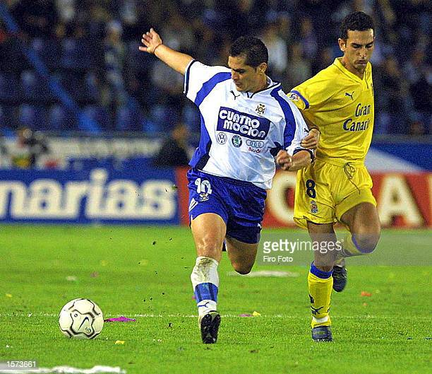 Hugo Morales of Tenerife and Pablo Lago of Las Palmas in action during the Spanish Primea Liga match played between Tenerife and Las Palmas at the...