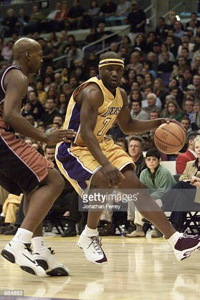 Isiah Rider of the Los Angeles Lakers drives to the hoop against the Utah Jazz at Staples Center in Los Angeles California DIGITAL IMAGE Mandatory...