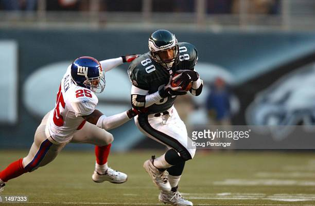 James Thrash of the Philadelphia Eagles is chased by Will Allen of the New York Giants during the game at Veterans Stadium in Philadelphia...