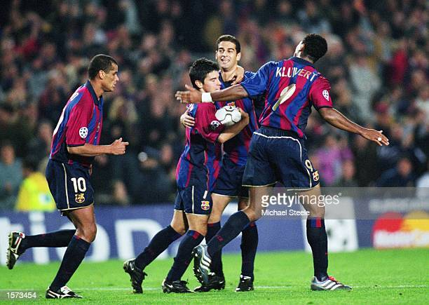 Javier Saviola of Barcelona is congratulated by team mate Gerard during the UEFA Champions League Second Phase Group B match between Barcelona and...