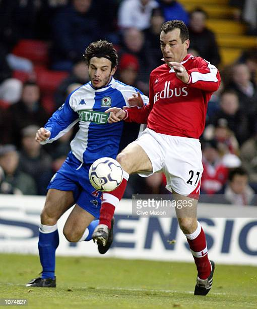 Jorge Costa of Charlton Athletic reaches the ball ahead of Corrado Grabbi of Blackburn Rovers during the FA Barclaycard Premiership match played at...
