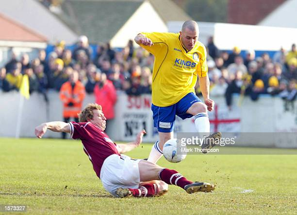 Julian Dicks of Canvey Island leaps over Marco Gabbriadini of Northampton Town during the AXA FA Cup second round match between Canvey Island and...