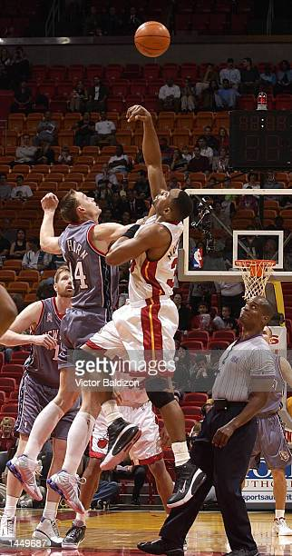 Keith Van Horn of the New Jersey Nets and Alonzo Mourning of the Miami Heat  go 3af3f7be3