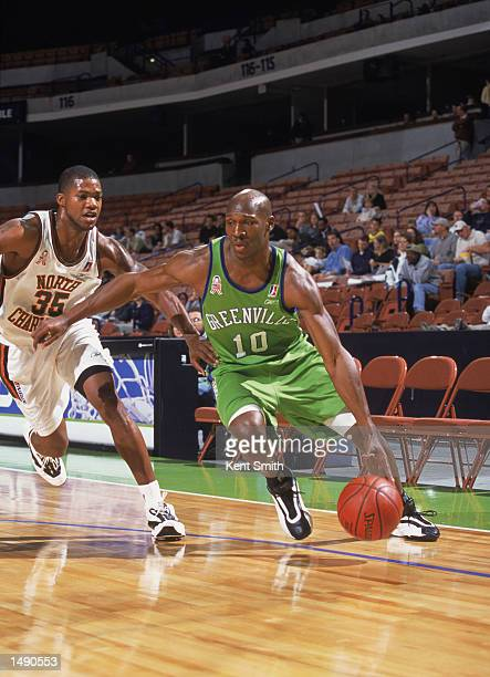 Kenny Gregory of the Greenville Groove drives past Galen Young of the North Charleston Lowgators during the NBDL game at the BiLo Center in...