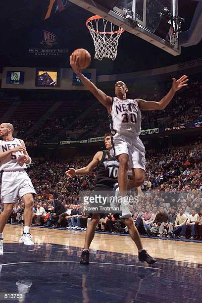 Kerry Kittles of the New Jersey Nets takes a shot during the game at Continental Airlines Arena in East Rutherford New Jersey DIGITAL IMAGE NOTE TO...