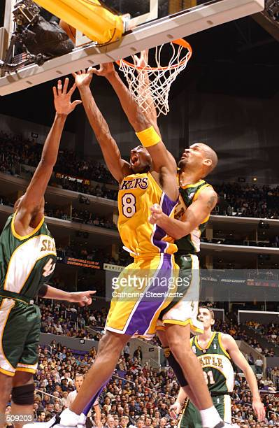 Kobe Bryant of the Los Angeles Lakers drives past Antonio Harvey of the Seattle SuperSonics during the first half at Staples Center in Los Angeles,...
