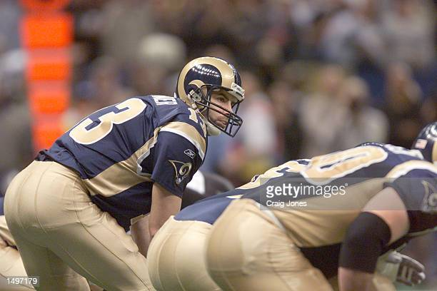 Kurt Warner of the StLouis Rams signals during the game against the New Orleans Saints at Louisiana Superdome in New Orleans Louisiana The Rams won...